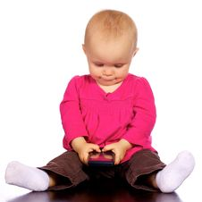 Free Infant Girl Playing With A Cell Phone Stock Images - 19800154