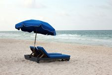 Free Umbrella Shaded Beach Lounge Chairs Stock Photo - 19800280