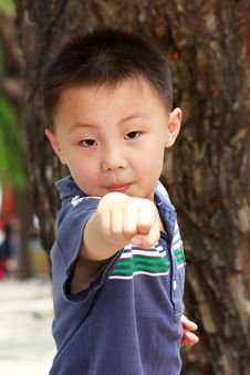 Free Asian Boy Is Doing Exercises Stock Photography - 19800342