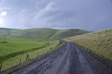 Gravel Rural Road Beneath Stormy Sky Stock Photos