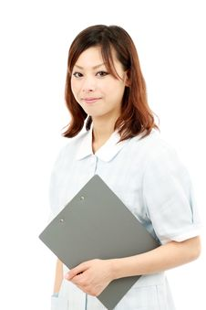 Young Asian Female Nurse Holding A Clipboard Royalty Free Stock Photos