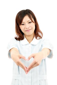 Free Young Asian Female Nurse Shows Fingers Heart Royalty Free Stock Photos - 19802818