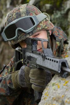 Soldier Aiming The Targer With A Rifle Royalty Free Stock Image