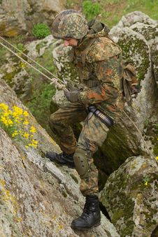 Free Soldier Climbing Down The Mountain Royalty Free Stock Images - 19803789