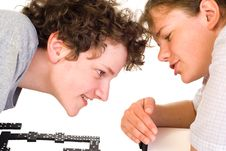 Boy And Girl Playing Dominoes Royalty Free Stock Images