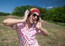 Young Man  With Headphones Stock Images