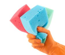 Hand In Glove Holding Washing Sponges Stock Image