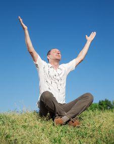 Free Man Meditating In Park Stock Photos - 19807413