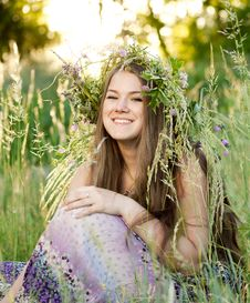 Free Woman Sitting On Grass In Park Royalty Free Stock Image - 19807596