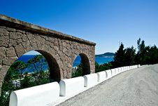 Free The Road With Arch Over Sea Stock Photos - 19808613