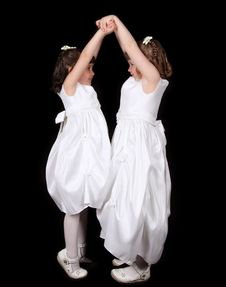 Playful Twin Sisters With Hands Joined In The Air Royalty Free Stock Photo