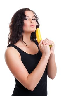 Woman With Fruit Gun Look At Camera Royalty Free Stock Image