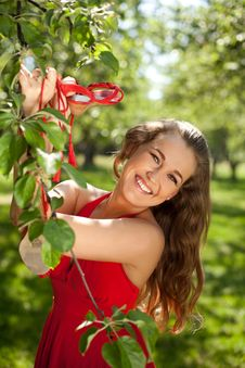 Beautiful Girl In Red Dress In The Park Stock Image