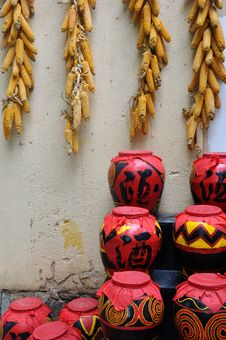 Chinese Style Drink Pot And Corn In Countryside Royalty Free Stock Photography