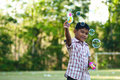 Free Asian Boy Playing Balloon Gun Toy Stock Image - 19820641