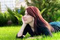 Free Pretty Woman Lying On Green Grass Stock Photo - 19824670