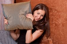 Smiling Girl Looks Out Of The Bag Royalty Free Stock Photos