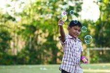 Free Asian Boy Playing Balloon Gun Toy Stock Image - 19820641