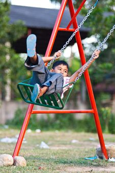 Free Asian Boy Playing Swing At Playground Stock Photo - 19820890