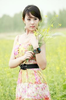 Summer Girl In Rape Field. Stock Images