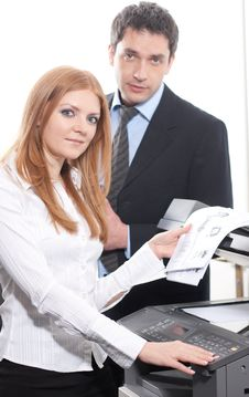 Girl With Documents Near Copy Machine Royalty Free Stock Photography