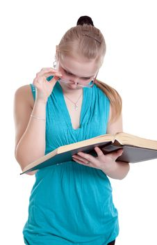 Free A Young Girl In Glasses With A Book Royalty Free Stock Image - 19825376