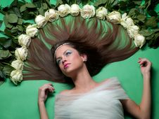 Free Girl Lay Among The Flowers Of Roses Royalty Free Stock Photography - 19826177