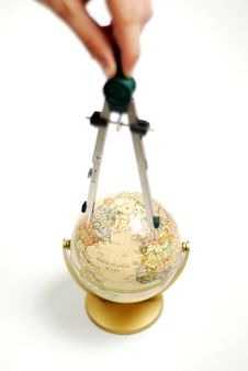 Compass On Globe Stock Images
