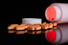 Free Pill Bottle With Orange Pills Royalty Free Stock Photography - 19826817