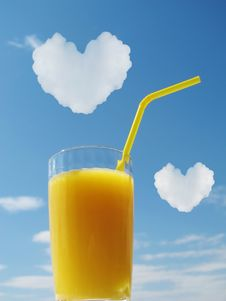 Free Orange Juice In Glass. Hearts In A Sky Stock Images - 19829564