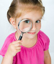 Free Little Girl Looking Through A Magnifying Glass Royalty Free Stock Images - 19833149