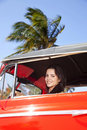 Free Beautiful Teen Driving Old Car And Smiling Stock Photography - 19833572