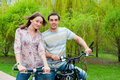 Free Happy Young Couple Riding Bicycles Royalty Free Stock Images - 19838439