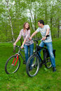 Free Happy Young Couple Riding Bicycles Royalty Free Stock Photos - 19838578