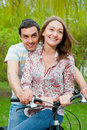 Free Happy Young Couple Riding Bicycles Stock Images - 19838604