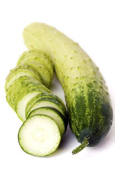 Two Cucumbers, One Whole And One Sliced Royalty Free Stock Photo