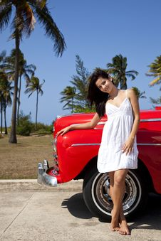 Free Pretty Young Woman And Old Red Car Royalty Free Stock Photo - 19833645