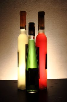 Free Three Bottles Of Wine In Three Colors Royalty Free Stock Images - 19834059