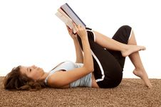 Laying Down Reading Book Stock Images