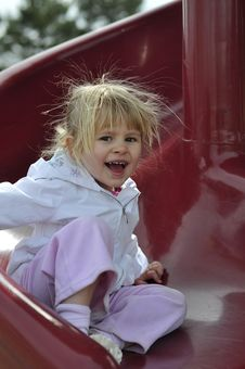 Happy Young  Girl On Slide Royalty Free Stock Image