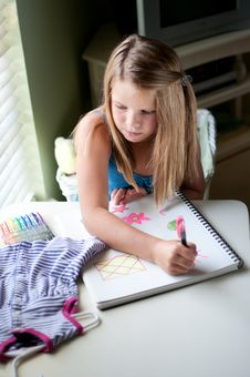 Free Young Girl Drawing Clothing By Window Stock Photos - 19838873