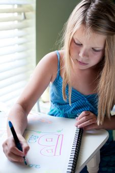 Free Young Girl Drawing By Window Royalty Free Stock Photography - 19838877
