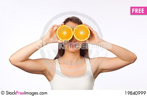 Free Young Woman With Halved Orange Royalty Free Stock Images - 19840999