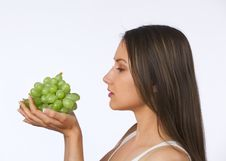 Free Young Woman Holding Fresh Grapes Royalty Free Stock Photography - 19841037