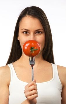 Free Young Woman With Fresh Tomato On Fork Royalty Free Stock Images - 19841149