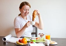 Free Woman Dunking Croissant In Coffee Royalty Free Stock Images - 19845549