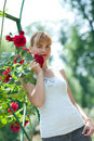 Free Young Pretty Woman Holding And Smelling Red Rose. Royalty Free Stock Photo - 19851015