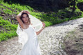 Free Attractive Bride With A Veil Poses On The Road Royalty Free Stock Images - 19852259