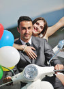 Free Just Married Couple Ride White Scooter Royalty Free Stock Photos - 19857598