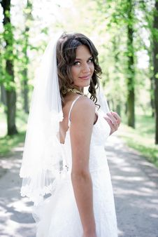 Free Young Bride Standing In An Alley In The Park Stock Image - 19852061